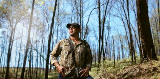 Dr. Drew Lanham stands in the woods for birding